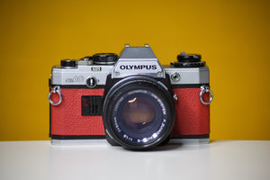 Olympus OM10 Slr Vintage 35mm Film Camera with Zuiko 50mm f1.8 Prime Lens Reconditioned with new red leather skin