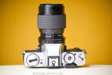 Load image into Gallery viewer, Minolta XG-M 35mm Film Camera with Tokina 80-200mm f/4.5 Zoom Lens