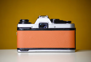 Olympus OM10 Slr Vintage 35mm Film Camera with G Zuiko 28mm f2.8 Prime Lens with Orange Skin