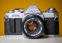 Load image into Gallery viewer, Canon AV-1 35mm Film Camera with Canon FD 50mm f/1.8 Prime lens