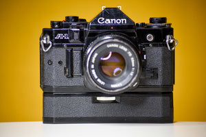 Canon A-1 Vintage 35mm Film Camera with Canon FD 50mm f/1.8 and Canon Winder A