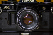 Load image into Gallery viewer, Canon A-1 Vintage 35mm Film Camera with Canon FD 50mm f/1.8 and Canon Winder A