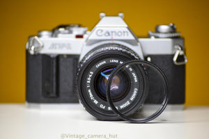 Canon AV-1 35mm Film Camera with Canon Zoom FD 35-70mm f/4 Prime Lens and Strap