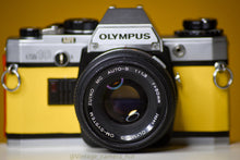 Load image into Gallery viewer, Olympus OM10 35mm Film Camera with Zuiko 50mm f/1.8 Prime Lens Reconditioned with new leather skin and painted