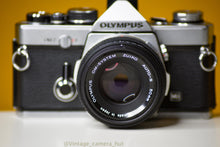 Load image into Gallery viewer, Olympus OM2 MD 35mm Film Camera with Zuiko 50mm f/1.8 Lens Filter and Lens Cap