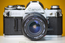 Load image into Gallery viewer, Canon AE-1 Vintage 35 Film Camera With Sigma Mini-Wide 28mm f/2.8 Lens