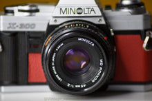 Load image into Gallery viewer, Minolta X-300 Vintage 35mm Film Camera with MInolta MD 45mm f/2 Prime Lens Reconditioned with New Red Skin