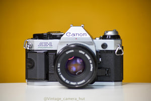 Canon AE-1 Program 35mm Film Camera with Canon FD 50mm f/1.8 Lens