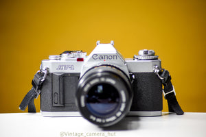 Canon AV-1 35mm Film Camera with Canon FD 135mm f/3.5 Prime Lens and Strap