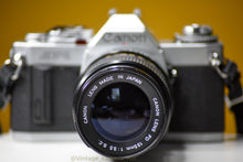 Load image into Gallery viewer, Canon AV-1 35mm Film Camera with Canon FD 135mm f/3.5 Prime Lens and Strap