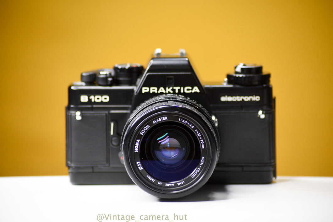 Praktica B100 35mm Film Camera with Sigma Zoom Master 35-70mm f/3.5 Lens