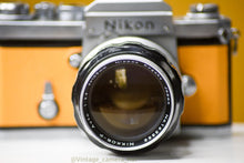 Load image into Gallery viewer, Nikon F 35mm Film Camera with Nikkor 105mm f/2.5 Lens with Eye Level Prism Finder Head