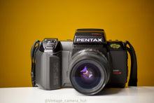 Load image into Gallery viewer, Pentax SFXn 35mm Film Camera with Pentax Smc Zoom 28-80mm f/3.5 Lens with Lens Filter And Strap