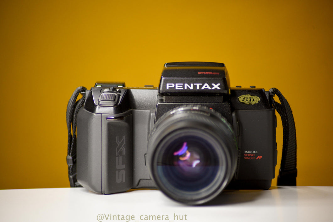 Pentax SFXn 35mm Film Camera with Pentax Smc Zoom 28-80mm f/3.5 Lens with Lens Filter And Strap