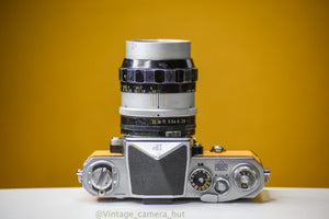 Nikon F 35mm Film Camera with Nikkor 105mm f/2.5 Lens with Eye Level Prism Finder Head