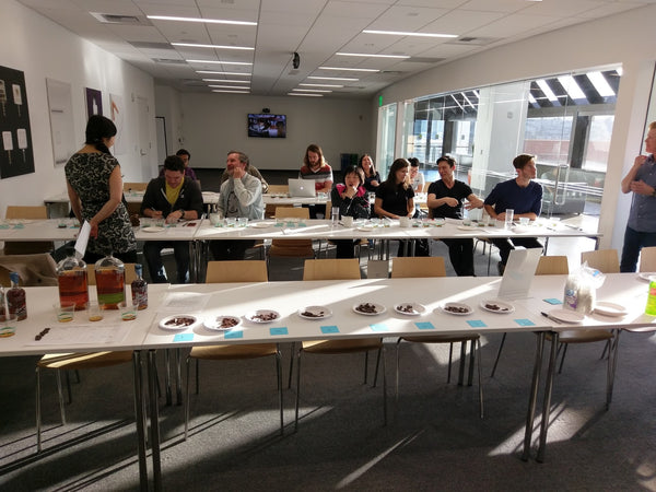 people in a room tasting chocolate