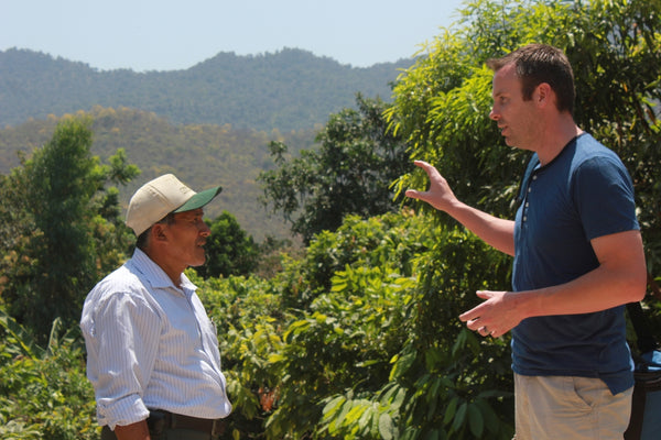 chocolate maker sharing information with cacao farmer