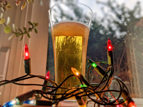 Skarey American Pilsner in a glass surrounded by twinkle lights.