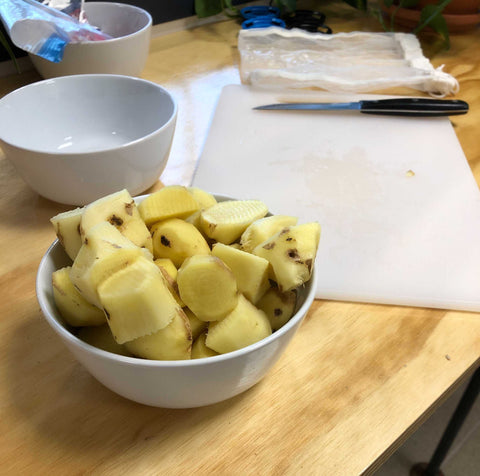 A small bowl filled with ginger ready for brewing.