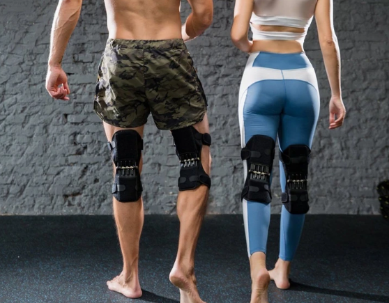 two pairs of Power knee Joint Support brace, knee Joint Support braces with spring on the back of a woman and a man's  knee