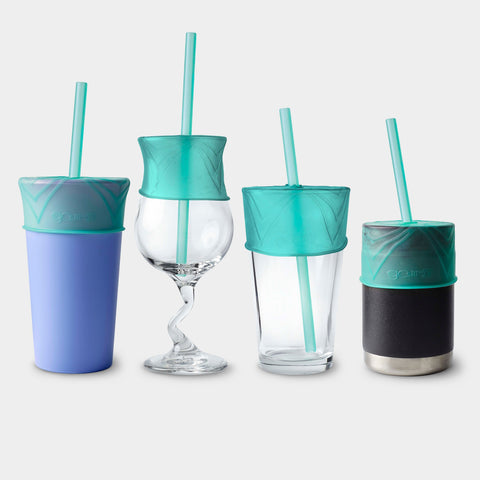 Four different cups in varying sizes and materials stand next to each other. Each one has a silicone lid and straw on it.