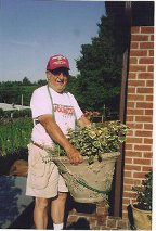Travis Hanes with flower pot carrier