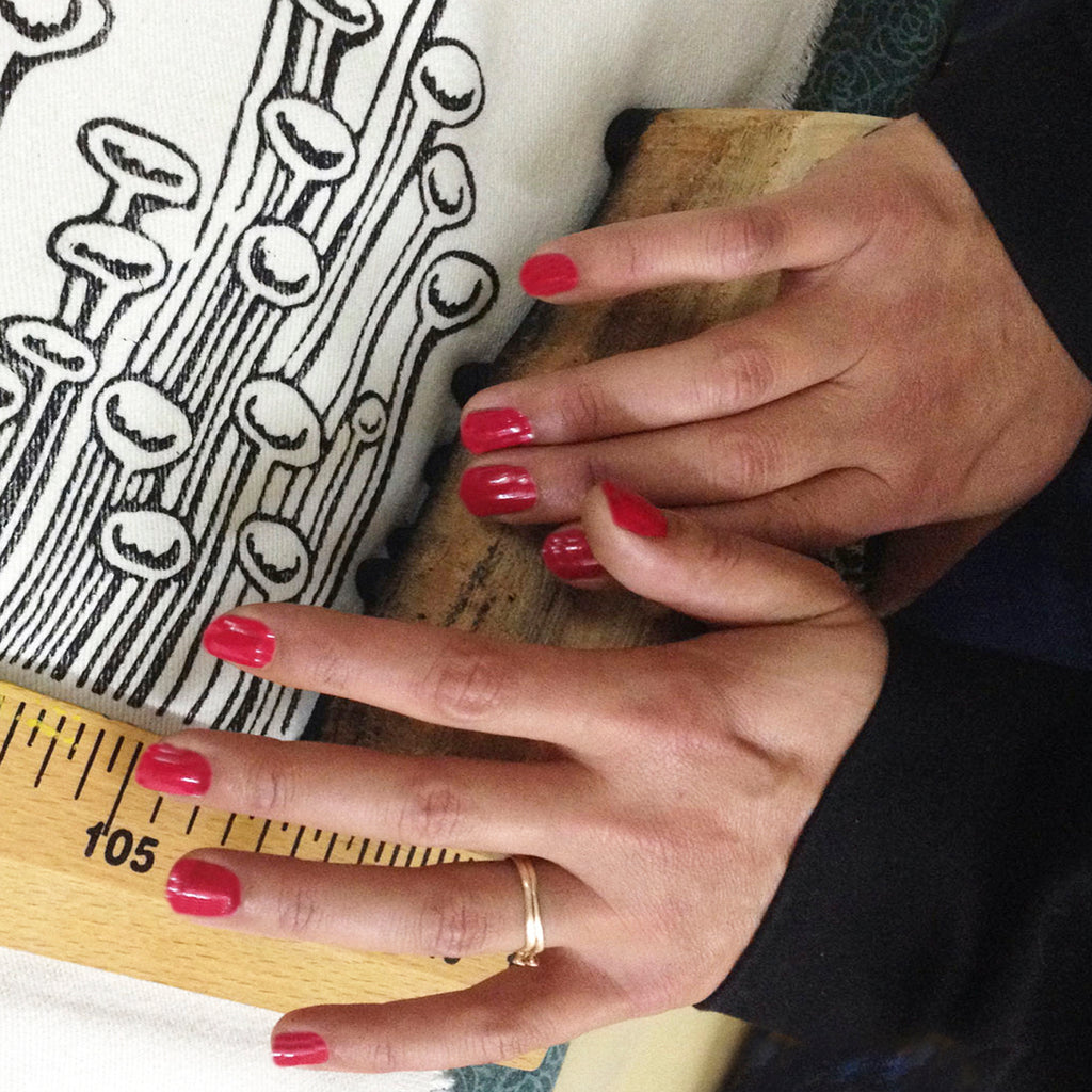 Our artisan woodblock printing the illustration on to our fabrics in their atelier.