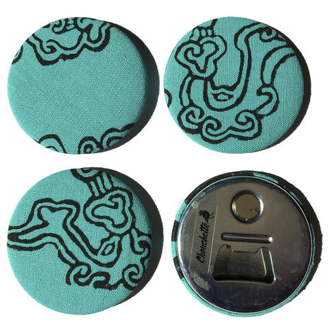 Four turquoise cloud magnet bottle openers, one showing the backside - Devrim Studio
