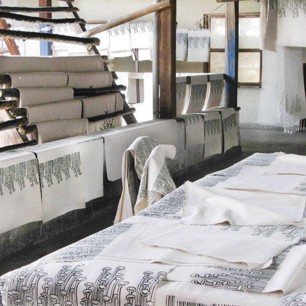 The block printed fabrics drying at the artisans studio - Devrim Studio