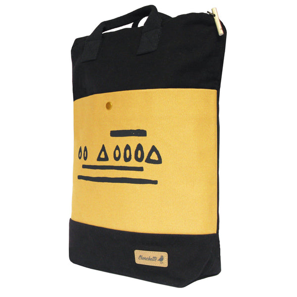 Side view of the yellow and black 'Hazelnut' Convertible Backpack, Tote Bag - Devrim Studio