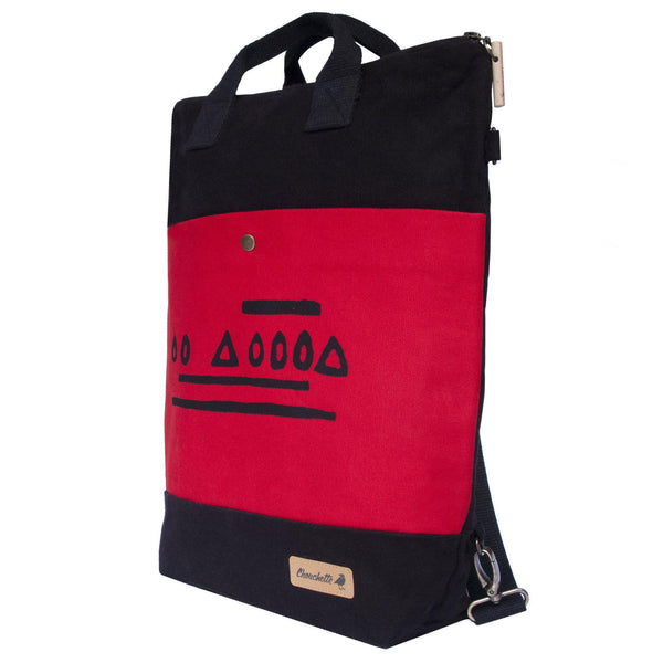 Side view of the red and black 'Hazelnut' Convertible Backpack, Tote Bag - Devrim Studio