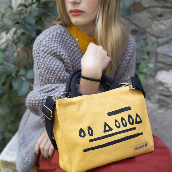 A woman holding the Yellow Hazelnut Mini Tote Bag, Shoulder Bag, Crossbody Bag-Devrim Studio