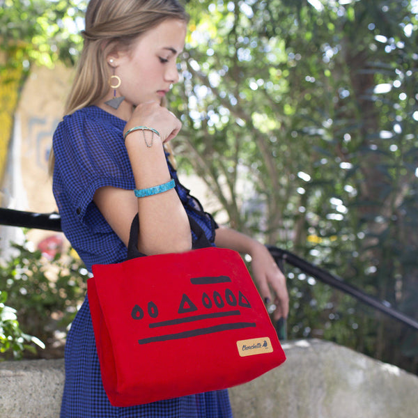 A woman wearing a red Hazelnut Waxed Canvas Mini Tote Bag, Shoulder Bag, Crossbody Bag-Devrim Studio