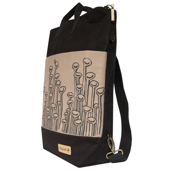 Side view of the black and beige 'Stuck To The Floor' convertible backpack, tote bag-Devrim Studio