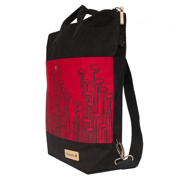 Side view of the black and red 'Stuck To The Floor' convertible backpack, tote bag-Devrim Studio