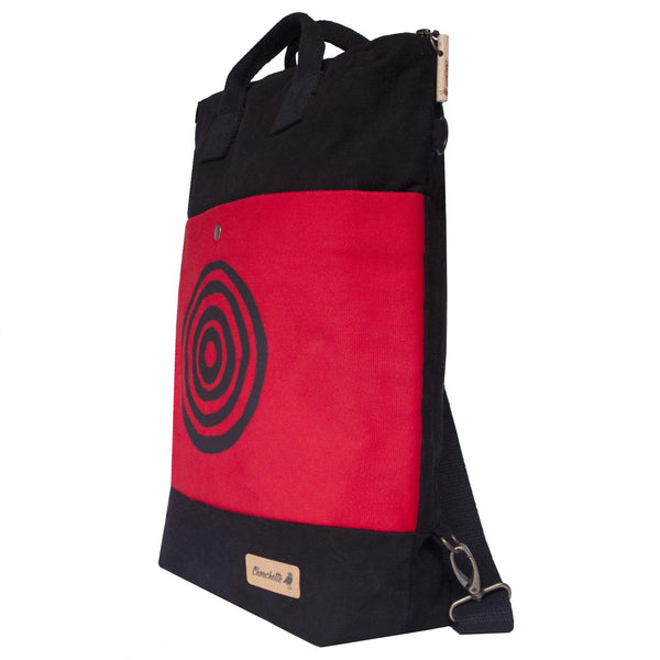 Side view of the red and black 'Time' Convertible Backpack, Tote Bag - Devrim Studio