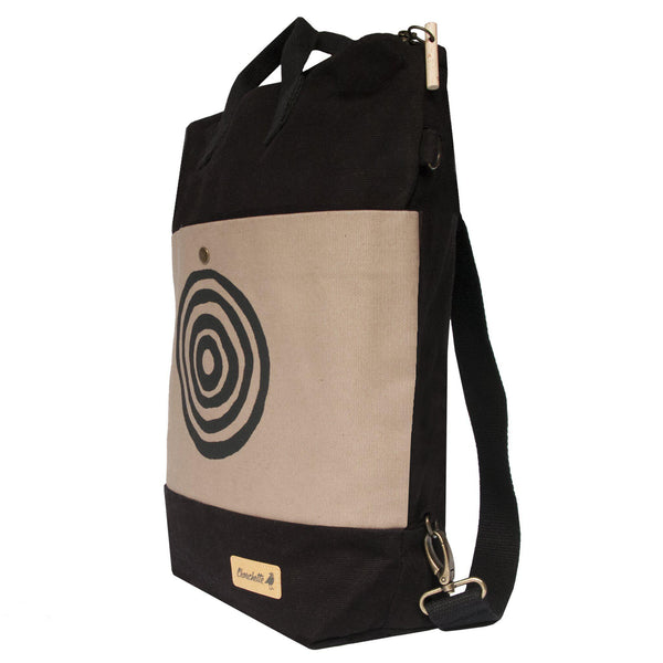 Side view of the beige and black 'Time' Convertible Backpack, Tote Bag - Devrim Studio