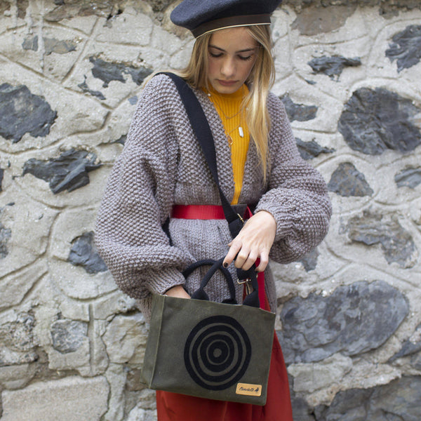 A woman wearing the 'Time' Waxed Canvas Mini Tote Bag as a shoulder bag- Devrim Studio