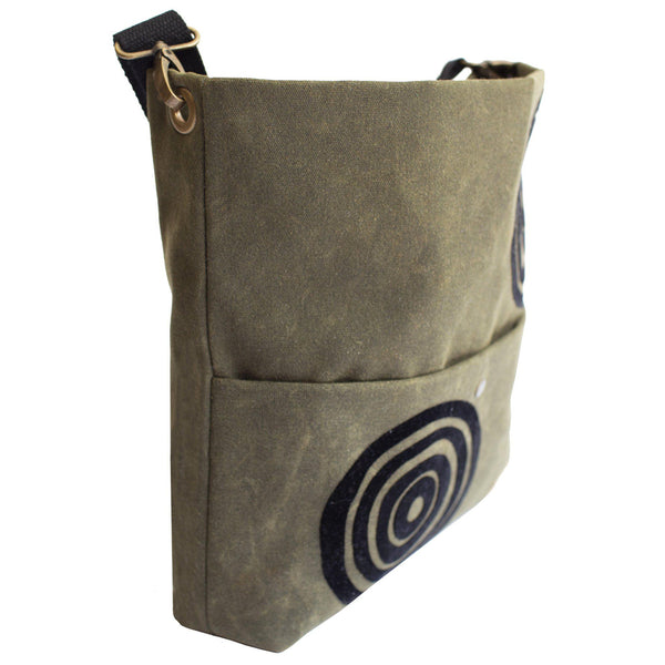 Side view of the khaki green 'Time' waxed canvas shoulder bag that converts into a crossbody bag - Devrim Studio