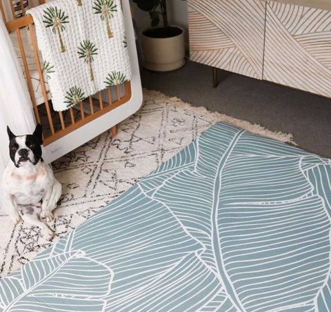 Social media influencer Simone Anderson's nursery featuring Wriggle Crew's Welcome to the Jungle Waterproof Padded Play Mat and Emerald Baby Kantha Quilt