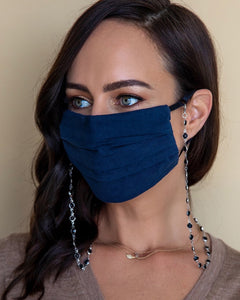 Sydne Summer wearing black and silver face mask chain with navy face mask