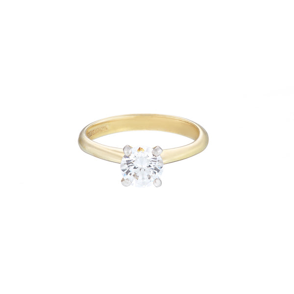 18ct yellow gold diamond solitaire ring with a round brilliant cut diamond set in white gold
