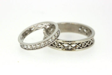 18ct white gold claddgh band for a man with the claddagh in the centre and filigree pattern around the band it is 4mm,  the ladies is 1/3 set white round brilliant cut diamonds.  This shows the backside of the ring where you can see the filigree pattern