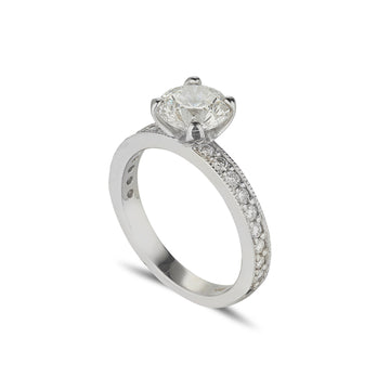platinum diamond solitaire ring with diamond set shoulders