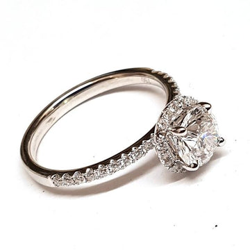 18ct white gold diamond halo solitaire engagement ring, the ring has a round brilliant cut diamond at the centre