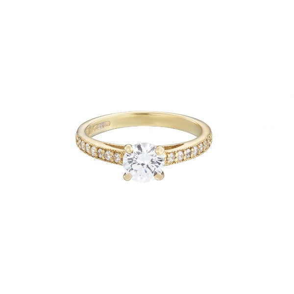 18ct yellow gold diamond solitaire ring with a round brilliant cut diamond set in white gold and diamond set shoulders