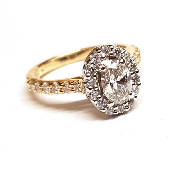 18ct yellow gold diamond oval halo engagement ring with diamond set shoulders