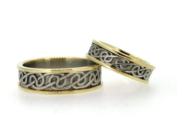 2 tone white gold inside with yellow gold rimms celtic design wedding rings