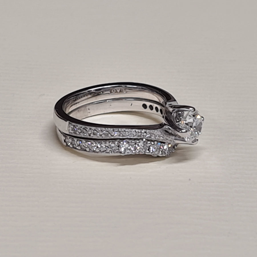 platinum diamond set twisted solitaire engagement ring with fitted wedding band