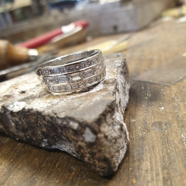 18ct white gold 3 row diamond  set wide ring looks like there is 3 channel set rings soldered together